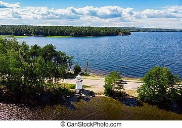 Aerial view of lighthouse on Pulkkilanharju Ridge at lake Paijanne, Paijanne National Park, Finland.