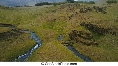 Aerial view of little river, stream became a powerful...
