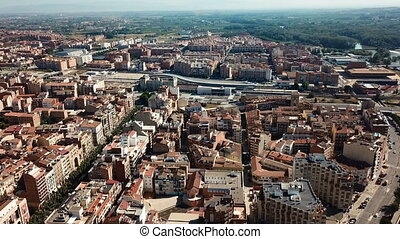 Aerial view of Lleida city with a apartment buildings and river, Spain