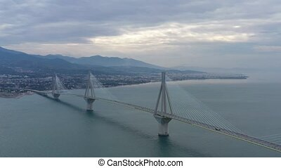 Aerial view of long cable-stayed Rio bridge in Greece at clouds weather