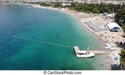 Aerial view of long coastline of Budva city, Montenegro....