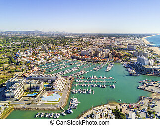 Aerial view of luxurious and touristic Vilamoura, Algarve, ...