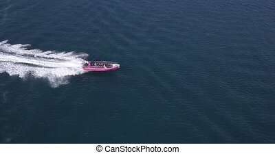 Aerial view of luxury motor boat racing on the water. High quality 4k footage