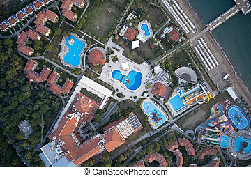 Aerial view of luxury resort hotel with swimming pools.