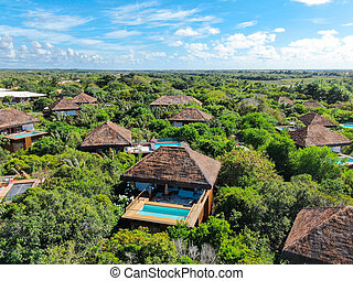 Aerial view of luxury villa with swimming pool in tropical forest, Praia do Forte, Brazil