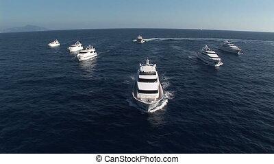 Aerial view of luxury yachts fleet