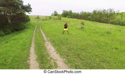 Aerial view of man doing exercise on the nature 4k