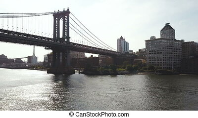 Aerial view of Manhattan bridge. Drone flying over the East river in New York in America, view on buildings of Brooklyn.