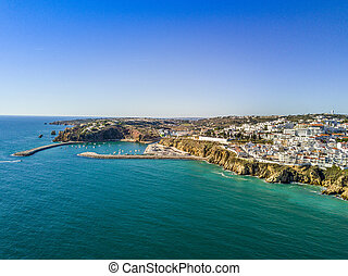 Aerial view of marina and cliffs in Albufeira, Algarve, ...