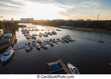 Aerial view of marina full  yachts and boats at sunset