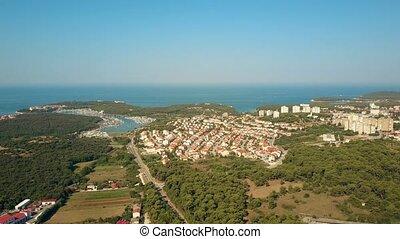 Aerial view of marina piers, the Adriatic sea coast and houses in Pula, Croatia