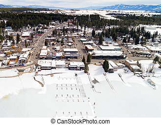 Aerial view of McCall Idaho with frozen boat docks in the lake and skyline