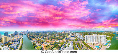 Aerial view of Miami Beach at sunset. Amazing panoramic skyline
