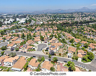 Aerial view of middle class neighborhood street with residential house