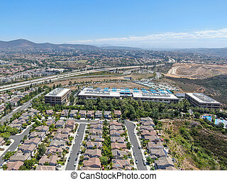Aerial view of middle class subdivision neighborhood with residential villas