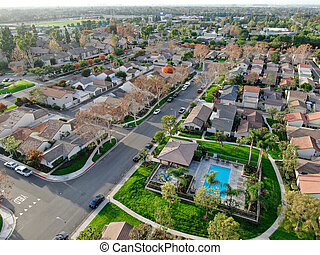 Aerial view of middle class suburban neighborhood with houses next to each othe