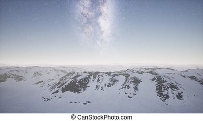 aerial view of Milky Way above snow covered terrain