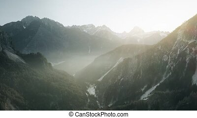 Aerial view of misty mountain valley in the Alps in northeastern Italy