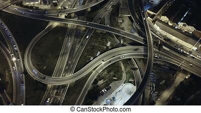 view of modern city highway grade separation in night lights...