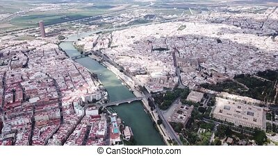 Aerial panoramic view of modern cityscape of Seville with Guadalquivir river, Spain