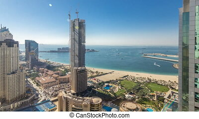 Aerial view of modern skyscrapers and beach at Jumeirah...