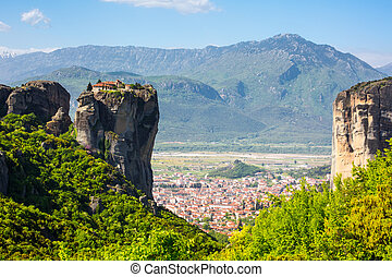 Aerial view of monastery at Meteora cliff and Kalambaka town, Greece