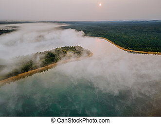 Aerial view of morning foggy on the lake, sunrise
