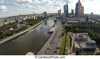 Aerial view of Moscow city with river and cloudy sky