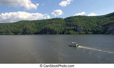 Aerial view of motor boat ride on lake.