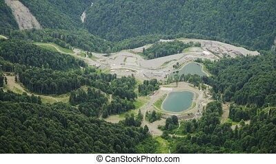 Aerial view of mountain lakes in ski resort. Beautiful mountains in summer