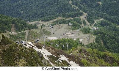 Aerial view of mountain ski resort. Beautiful mountains in spring
