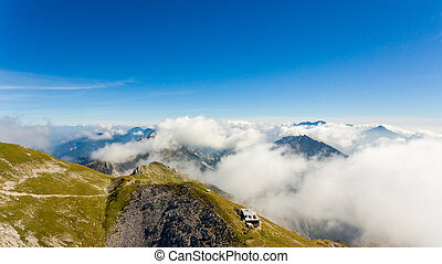 Aerial view of mountain top with cabin. Stol in Karavanke,...