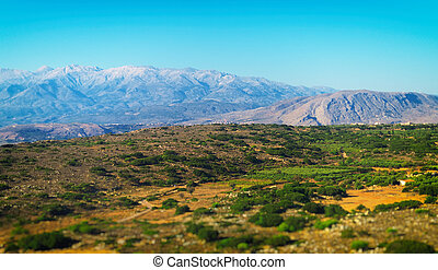 Aerial view of mountains and desert.