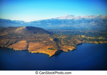 Aerial view of mountains and sea.