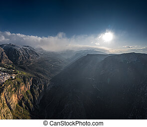 Aerial view of mountains at sunrise, Morning fog over mountains, Sun beams