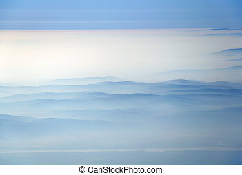 Aerial view of mountains in clouds