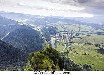 aerial view of mountains, rivers, fields and meadows