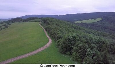 Aerial view of mountains with green field and road in the Slovak Tatras