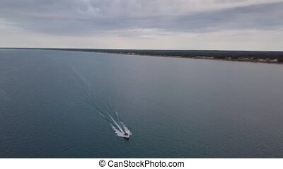 Aerial view of moving boat on the lake. 4k. - Flying with...