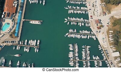Aerial view of multiple parked motorboats and sailboats at...