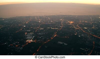 Aerial view of Naples cityscape and harbor in late evening