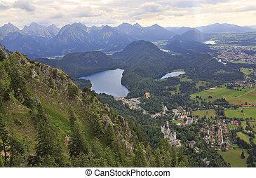 Aerial view of Neuschwanstein Castle, Alpsee Lake, Fussen...