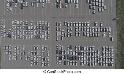 Aerial view of new car storage parking lot. Car park view from above.