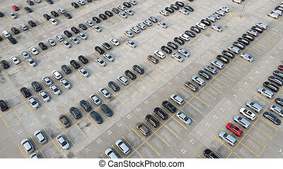 Aerial view of new cars lined up parking outside factory on car factory background. Industrial concept.