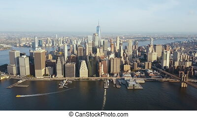 Aerial view of New York, America. Drone flying over the East river and Manhattan downtown on the shore.