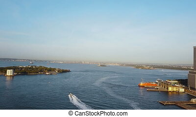 Aerial view of New York, America. Famous sights East river, Governors island and statue of liberty on the horizon.