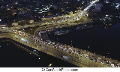 Aerial view of night city Kyiv, Kiev, with car traffic.