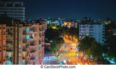 Aerial view of night city traffic in Antalya, Turkey. Motion timelapse.
