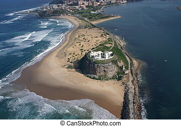Aerial view of Nobbys lighthouse and beach. Newcastle Australia