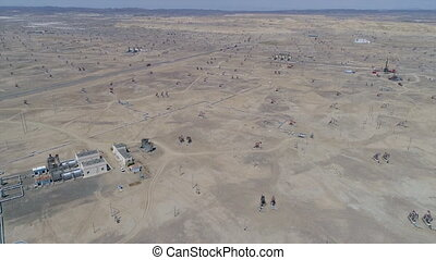 Aerial view of oil field operation and pipeline in Xinjiang ...